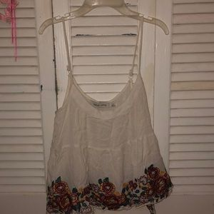 White tank top with lace and flowers on bottom